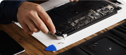 a tech mechanic removing tech components in a motherboard for monetization purpose